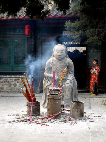 China incense burning in front of idol